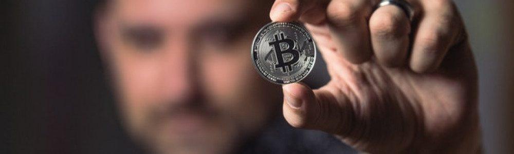 person-holding-silver-bitcoin-coin-1447418